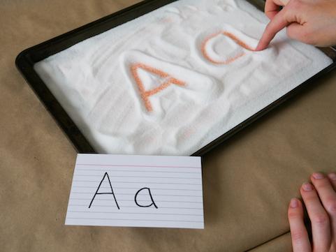 salt tray writing preschool sensory activity